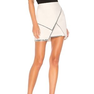 Carly studded mini skirt in of white